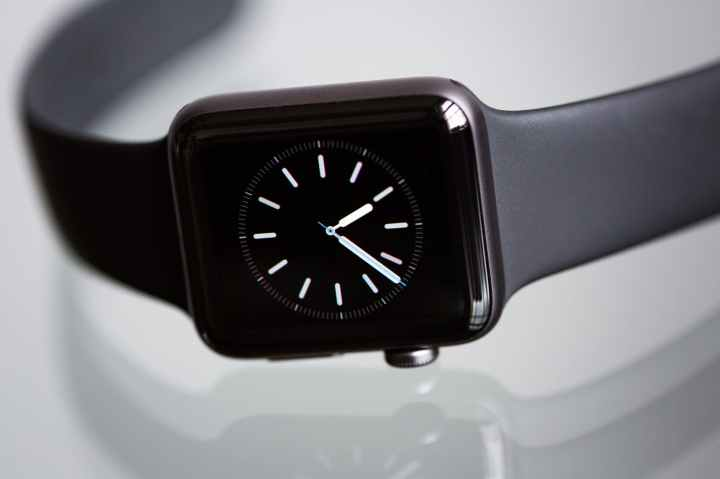 Apple Watch in Space Gray with a black sport band.